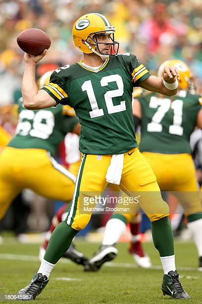 Aaron Rodgers of the Green Bay Packers throws against the the Washington Redskins at Lambeau Field on September 15 2013 in Green Bay Wisconsin