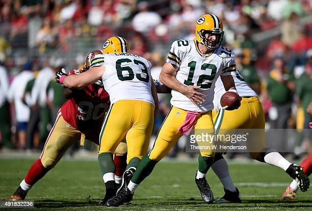 Aaron Rodgers of the Green Bay Packers turns to hand the ball off to a running back against the San Francisco 49ers during their NFL football game at...