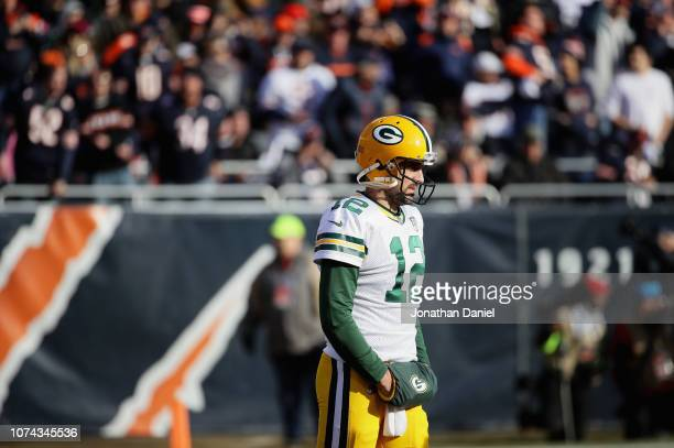 Aaron Rodgers of the Green Bay Packers waits for the start of play during a television commercial against the Chicago Bears at Soldier Field on...