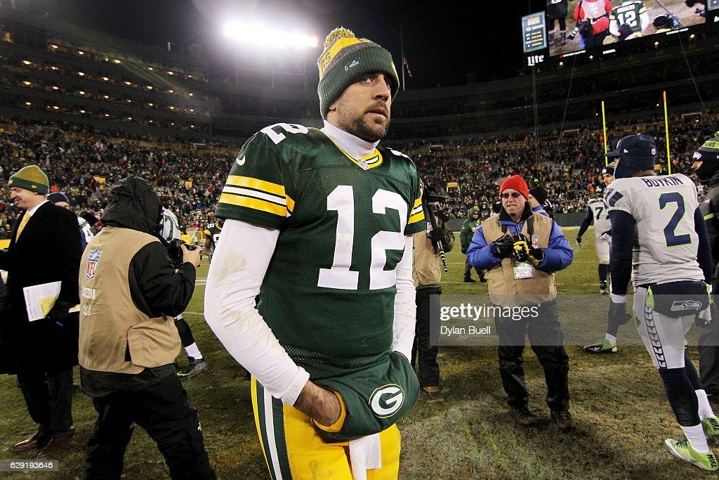 Aaron Rodgers #12 of the Green Bay Packers walks across the field after the Green Bay Packers beat the Seattle Seahawks 38-10 at Lambeau Field on December 11, 2016 in Green Bay, Wisconsin.