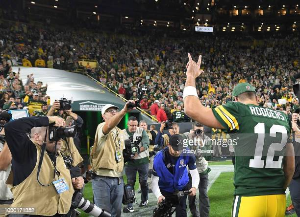 Aaron Rodgers of the Green Bay Packers walks off the field after a game against the Chicago Bears at Lambeau Field on September 9 2018 in Green Bay...