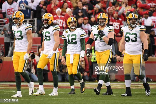 Aaron Rodgers of the Green Bay Packers walks off the field after a sack on third down in the first half against the San Francisco 49ers during the...