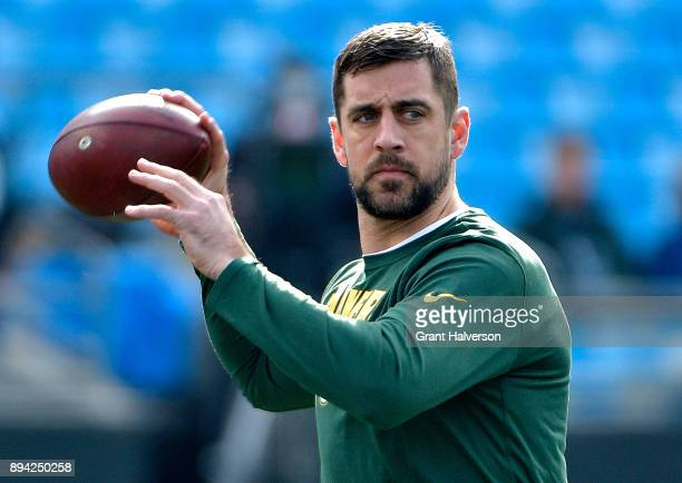 Aaron Rodgers of the Green Bay Packers warms up before their game against the Carolina Panthers at Bank of America Stadium on December 17 2017 in...