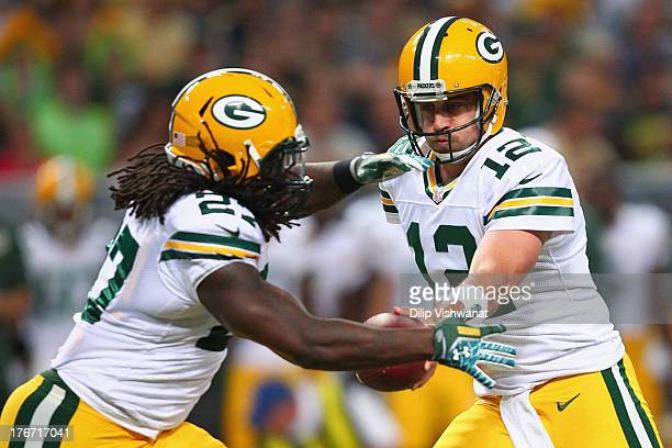 Aaron Rodgers of the Green Bay Packershands the ball off to Eddie Lacy of the Green Bay Packers during a preseason game against the St Louis Rams at...