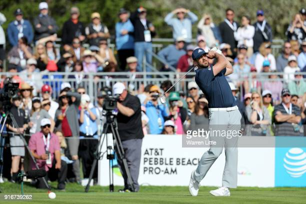 Aaron Rodgers plays his shot from the 17th tee during Round Three of the ATT Pebble Beach ProAm at Spyglass Hill Golf Course on February 10 2018 in...