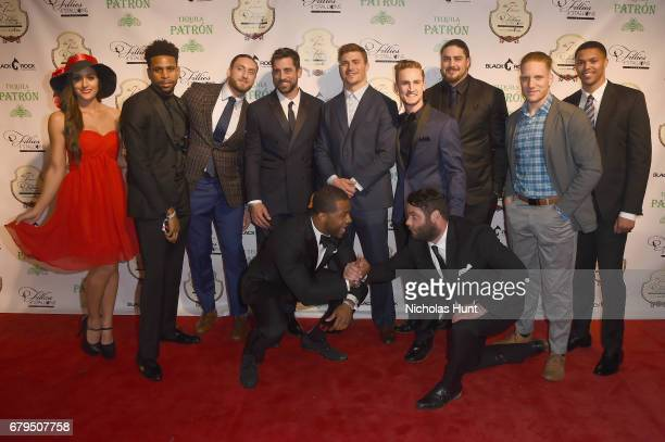 Aaron Rodgers poses with Green Bay Packers players at the 7th Annual Fillies Stallions Kentucky Derby Party hosted by Black Rock Thoroughbreds and...