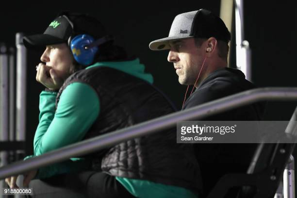 Aaron Rodgers quarterback for the Green Bay Packers looks on from the pit box of Danica Patrick driver of the GoDaddy Chevrolet during the Monster...