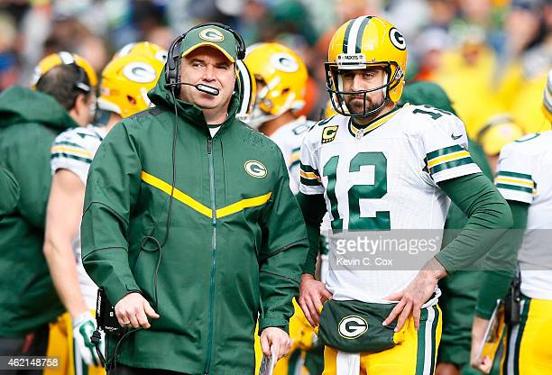 Aaron Rodgers speaks with head coach Mike McCarthy of the Green Bay Packers against the Seattle Seahawks during the 2015 NFC Championship game at...
