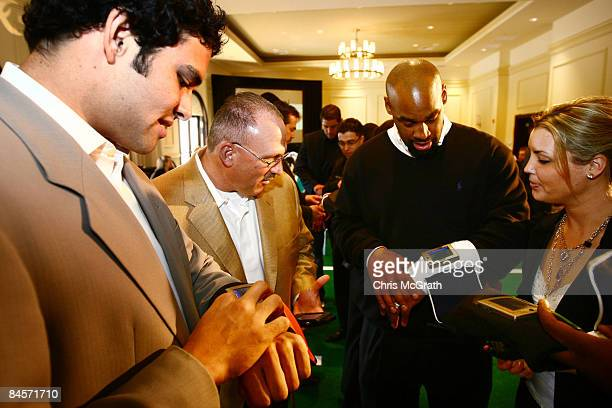 Aaron Rodgers, Tony Sparano and Donovan McNabb play with the ID Coach Wristband at the launch of the Isaac Daniel, ID Coach at the Sheraton Riverwalk...