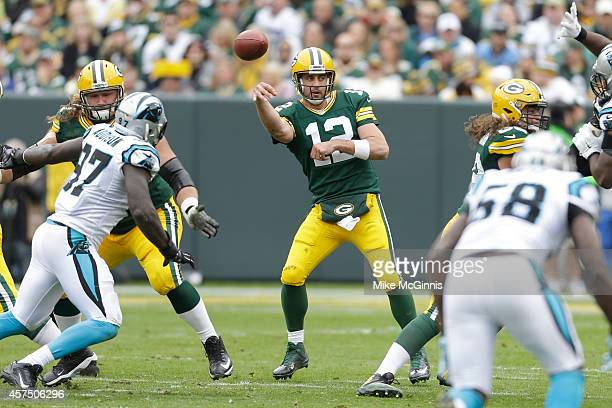 Aaron Rogers of the Green Bay Packers passes the football during the third quarter against the Carolina Panthers at Lambeau Field on October 19 2013...