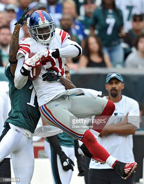 Aaron Ross of the New York Giants intercepts a pass in front of DeSean Jackson of the Philadelphia Eagles at Lincoln Financial Field on September 25,...