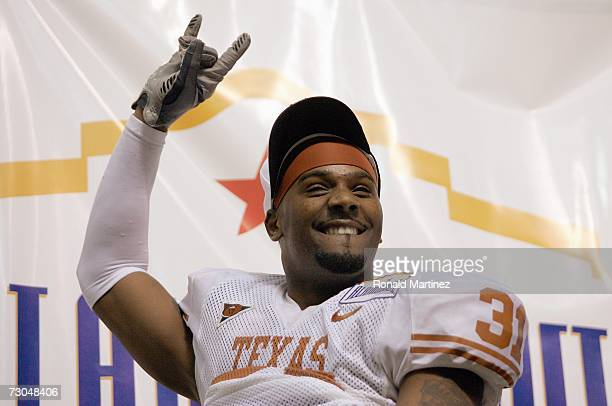 Aaron Ross of the Texas Longhorns celebrates after the win against the Iowa Hawkeyes during the Alamo Bowl on December 30 2006 at the Alamodome in...