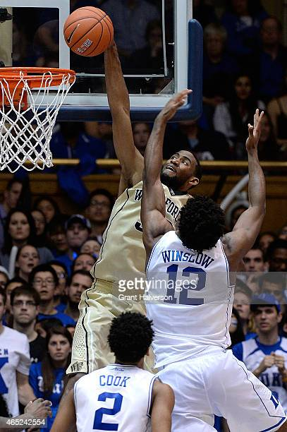 Aaron Rountree III of the Wake Forest Demon Deacons dunks over Justise Winslow of the Duke Blue Devils during their game at Cameron Indoor Stadium on...
