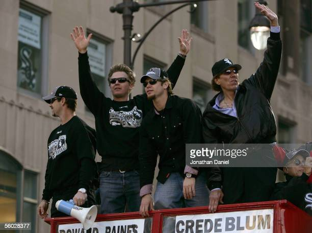 Aaron Rowand Geoff Blum Joe Crede and announcer Ed Farmer of the Chicago White Sox wave to the crowd at the White Sox victory parade and rally on...