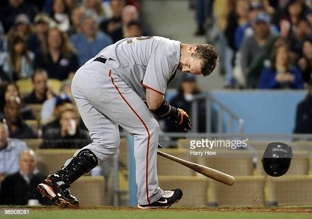 Aaron Rowand of the San Francisco Giants reacts after being hit in the head by a pitch from Vicente Padilla of the Los Angeles Dodgers during the...