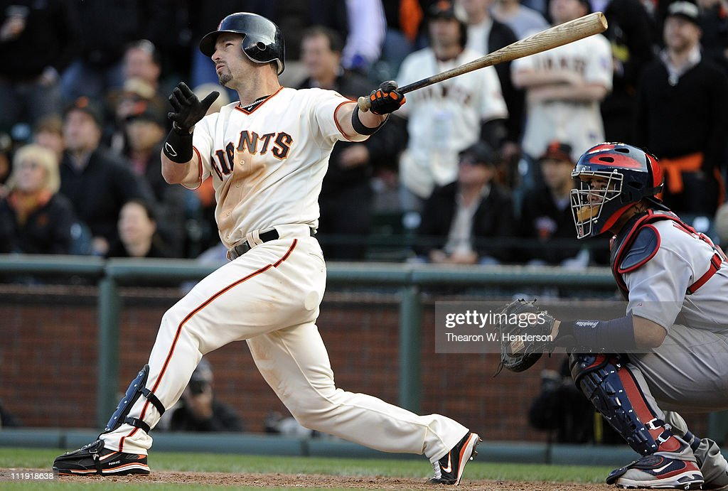 Aaron Rowand #33 of the San Francisco Giants swings and watches the flight of his ball as he singles home Andres Torres in the bottom of the 12th inning to win the game 5-4 against the St. Louis Cardinal at AT&T Park April 8, 2011 in San Francisco, California.