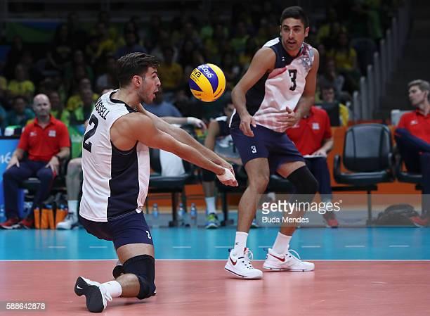 Aaron Russell of the United States in action against Brazil during the men's qualifying volleyball match between Brazil and United States on Day 6 of...
