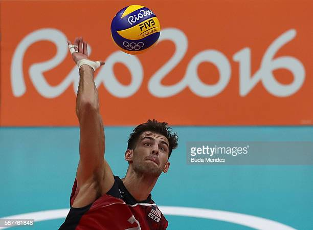 Aaron Russell of the United States spikes the ball during the men's qualifying volleyball match between the United States and Italy on Day 4 of the...
