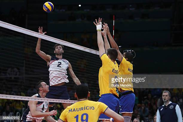 Aaron Russell of the United States spikesthe ball during the men's qualifying volleyball match between Brazil and United States on Day 6 of the Rio...