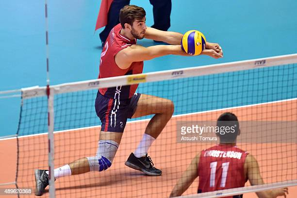 Aaron Russell of the USA receives in the match between USA and Argentina during the FIVB Men's Volleyball World Cup Japan 2015 at Yoyogi National...