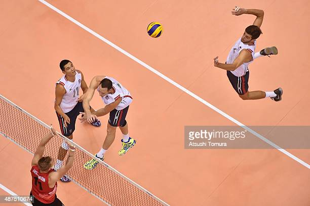 Aaron Russell of the USA spikes in the match between Canada and USA during the FIVB Men's Volleyball World Cup Japan 2015 at the Hiroshima Green...