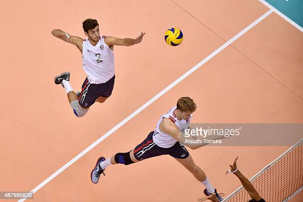 Aaron Russell of the USA spikes in the match between Egypt and USA during the FIVB Men's Volleyball World Cup Japan 2015 at the Hiroshima Green Arena...