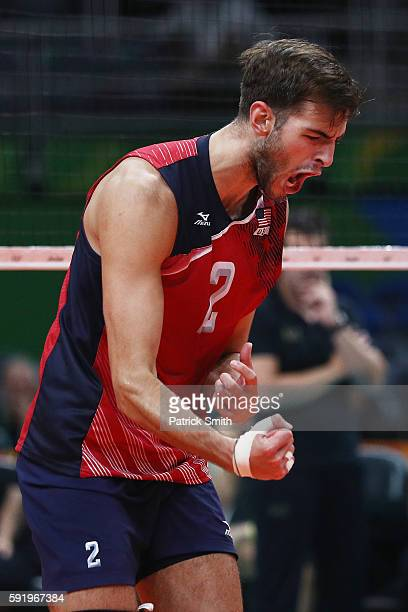 Aaron Russell of United States celebrates a point over Italy during the Men's Volleyball Semifinal match on Day 14 of the Rio 2016 Olympic Games at...