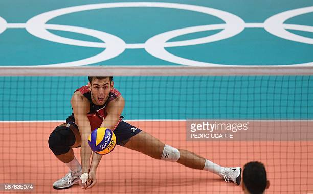 US Aaron Russell plays a shot during the men's qualifying volleyball match between Italy and the USA at the Maracanazinho stadium in Rio de Janeiro...