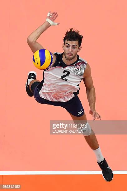 US Aaron Russell prepares to spike the ball during the men's qualifying volleyball match between the USA and France at the Maracanazinho stadium in...