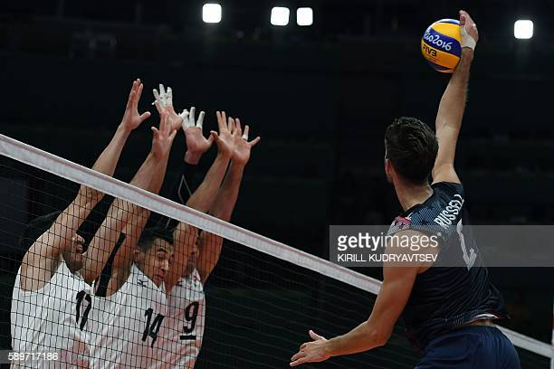 US Aaron Russell spikes the ball during the men's qualifying volleyball match between the USA and Mexico at the Maracanazinho stadium in Rio de...