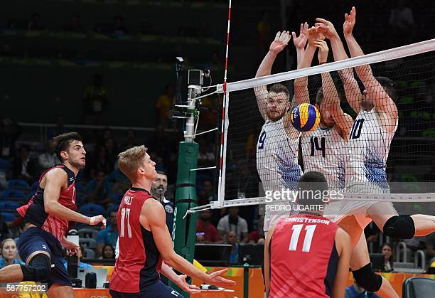 US Aaron Russell US Maxwell Holt and US Micah Christenson watch as Italy's Ivan Zaytsev Italy's Matteo Piano and Italy's Filippo Lanza fail attempt...