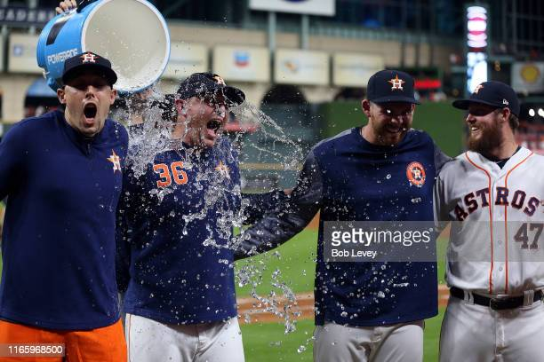 Aaron Sanchez of the Houston Astros Will Harris Joe Biagini and Chris Devenski are doused with water by Collin McHugh after combining for a no hitter...