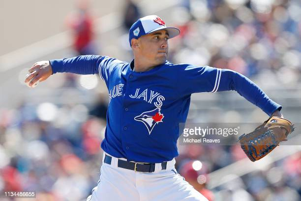 Aaron Sanchez of the Toronto Blue Jays delivers a pitch against the Philadelphia Phillies during the Grapefruit League spring training game at...
