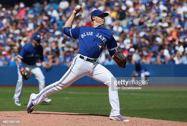 Aaron Sanchez of the Toronto Blue Jays delivers a pitch in the eighth inning during MLB game action against the Kansas City Royals on August 2 2015...