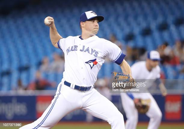 Aaron Sanchez of the Toronto Blue Jays delivers a pitch in the first inning during MLB game action against the Tampa Bay Rays at Rogers Centre on...