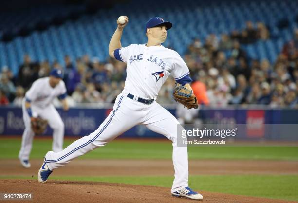 Aaron Sanchez of the Toronto Blue Jays delivers a pitch in the first inning during MLB game action against the New York Yankees at Rogers Centre on...