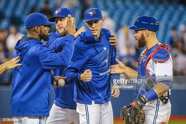 TORONTO ON MAY 8 Aaron Sanchez of the Toronto Blue Jays get high fives from Jose Reyes Mark Buehrle and Russell Martin as the Toronto Blue Jays...