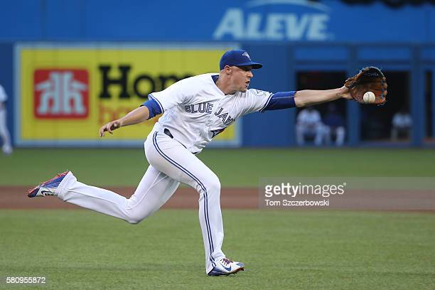 Aaron Sanchez of the Toronto Blue Jays gets to an infield single by Alex Dickerson of the San Diego Padres but cannot throw him out in the fourth...