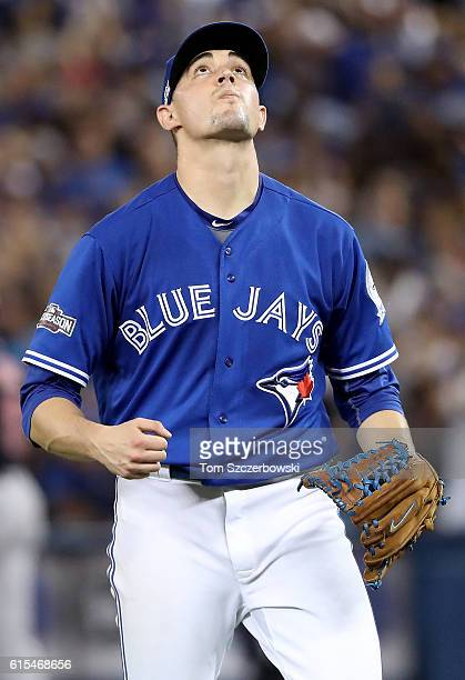 Aaron Sanchez of the Toronto Blue Jays reacts as he walks back to the dugout after pitching in the third inning against the Cleveland Indians during...