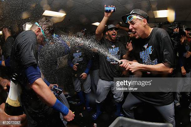 Aaron Sanchez of the Toronto Blue Jays, righ, celebrates the Toronto Blue Jays' 2-1 win over the Boston Red Sox, clinching a Wildcard spot in the...