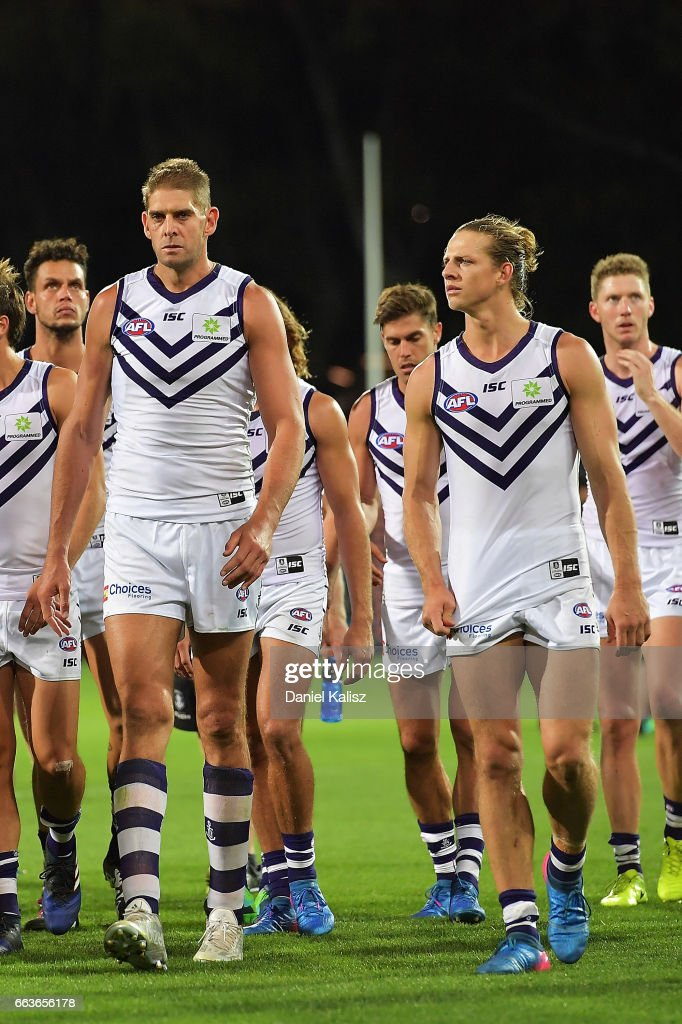 Aaron Sandilands and Nat Fyfe of the Dockers walk from the field after the round two AFL match between the Port Adelaide Power and the Fremantle Dockers at Adelaide Oval on April 2, 2017 in Adelaide, Australia.