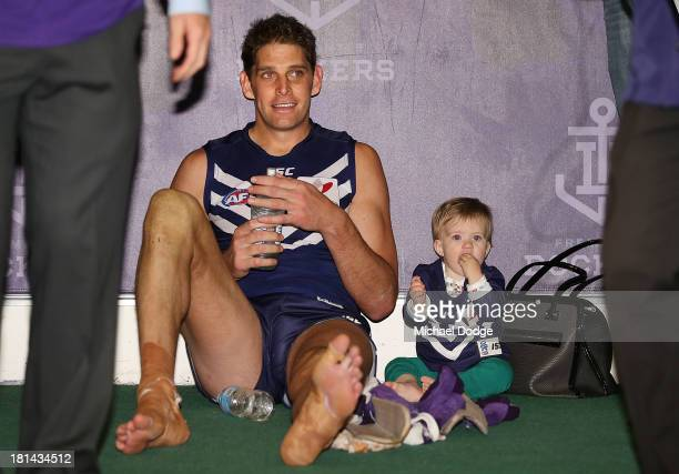 Aaron Sandilands of the Dockers celebrates the win with daughter Sloane Ellie Sandilands during the AFL Second Preliminary Final match between the...