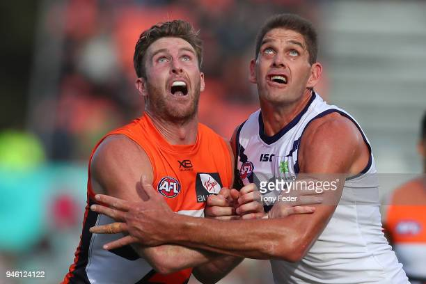 Aaron Sandilands of the Dockers contests the ruck with his Giants opponent during the round four AFL match between the Greater Western Sydney Giants...