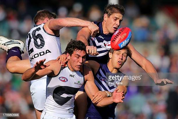 Aaron Sandilands of the Dockers crashes over Tom Downie of the Giants in a marking contest during the round 20 AFL match between the Fremantle...