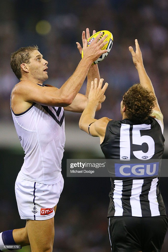 Aaron Sandilands of the Dockers marks the ball against Jarrod Witts of the Magpies during the round one AFL match between the Collingwood Magpies and the Fremantle Dockers at Etihad Stadium on March 14, 2014 in Melbourne, Australia.