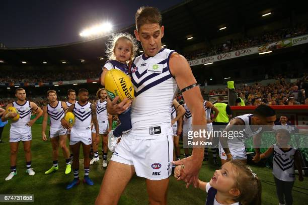 Aaron Sandilands of the Dockers walks onto the field with his children for his 250th AFL game during the round six AFL match between the West Coast...