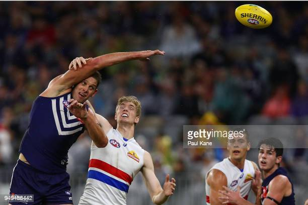 Aaron Sandilands of the Dockers wins a boundary throw in against Tim English of the Bulldogs during the round five AFL match between the Fremantle...