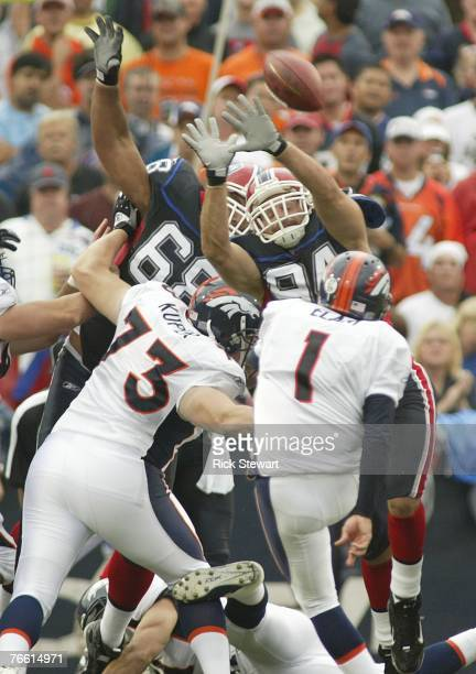 Aaron Schobel of the Buffalo Bills attempts to block a field goal by Jason Elam of the Denver Broncos at Ralph Wilson Stadium September 9, 2007 in...