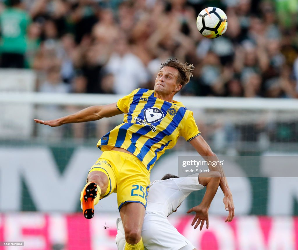 Aaron Schoenfeld of Maccabi Tel Aviv FC battles for the ball in the air with Stefan Spirovski of Ferencvarosi TC during the UEFA Europa League First Qualifying Round 1st Leg match between Ferencvarosi TC and Maccabi Tel Aviv FC at Groupama Arena on July 12, 2018 in Budapest, Hungary.
