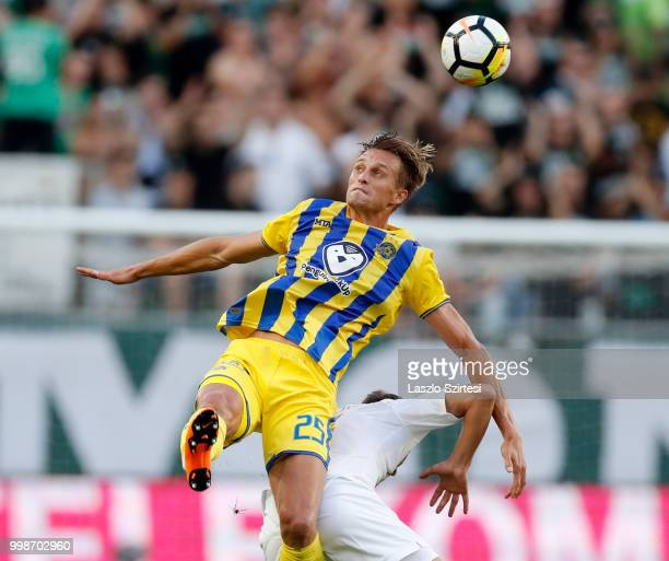Aaron Schoenfeld of Maccabi Tel Aviv FC battles for the ball in the air with Stefan Spirovski of Ferencvarosi TC during the UEFA Europa League First...